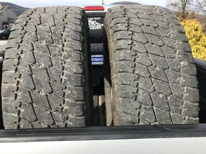 Two LT285-70-R17 tires