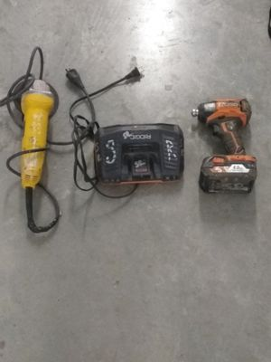 Impack gun, battery, charger, laser, 3 tool bags, hand tools