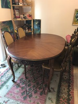 Antique dining table and chairs set