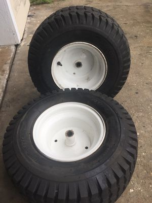 Riding mower rims & tires! Good condition !$20