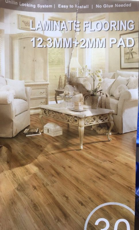 Timberlake Colonial Walnut 12mm Laminate Flooring with attached pad