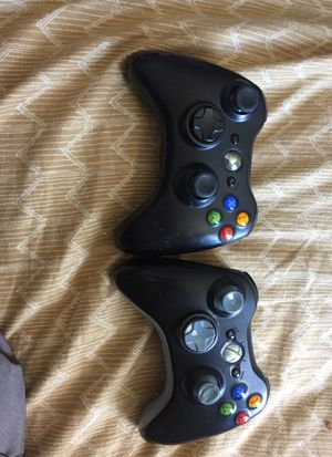 Two Xbox controllers