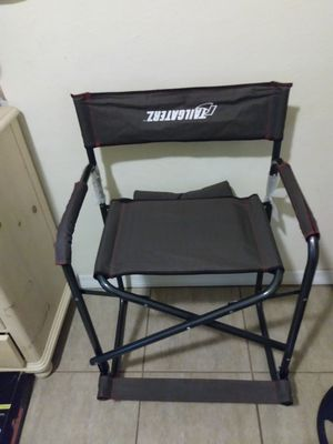 Folding chair with cushion made by Tailgaterz