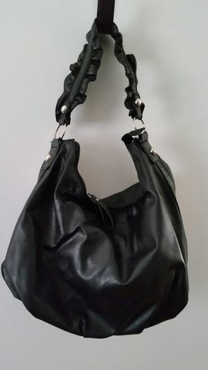 Black purse with ruffled strap