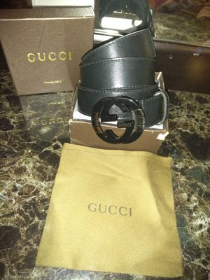 Black Gucci with black an gold buckle