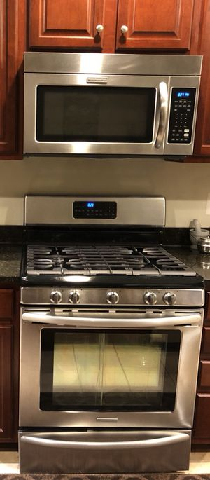 Kitchen Aid stainless steel gas range, microwave and dishwasher