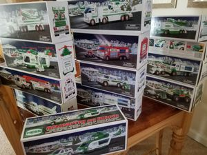14 Hess Trucks, 1999 through 2010, 2 duplicates, most new in box. Get that special little one a Christmas present to remember. $110