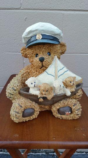 Bear with sailboat figurine