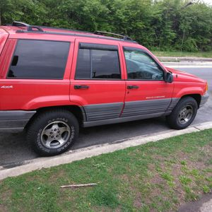 1997 RED GRAND JEEP CHEROKEE