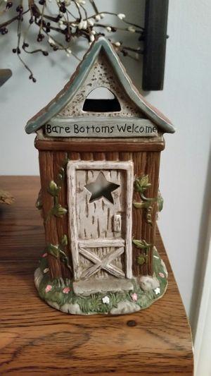 Ceramic outhouse figurine