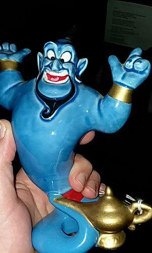Disney genie statue