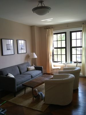 Pottery Barn couch, upholstered chairs, coffee table AND rug available