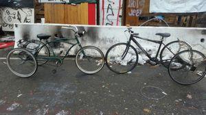 Two Schwinn three wheelers one old/one new