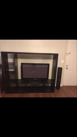 Selling both tv and entertainment center