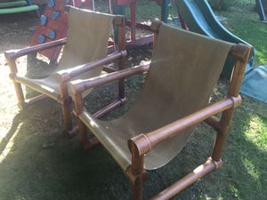 Antique leather sling back chairs