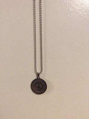 Piece sign necklace