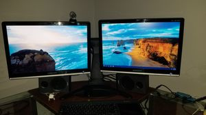 Dual Samsung computer monitors on a single stand