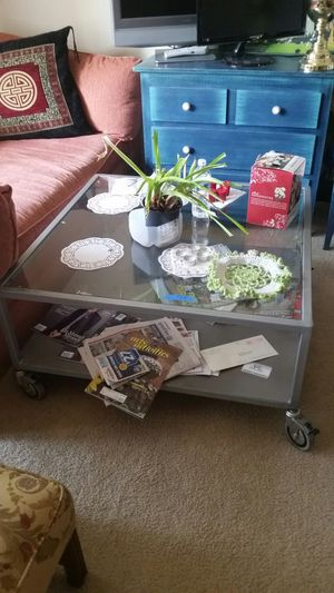 "COFFEE GLASS TABLE WITH WHEELS EXCELLENT CONDITION SIZE 36""X 36 """