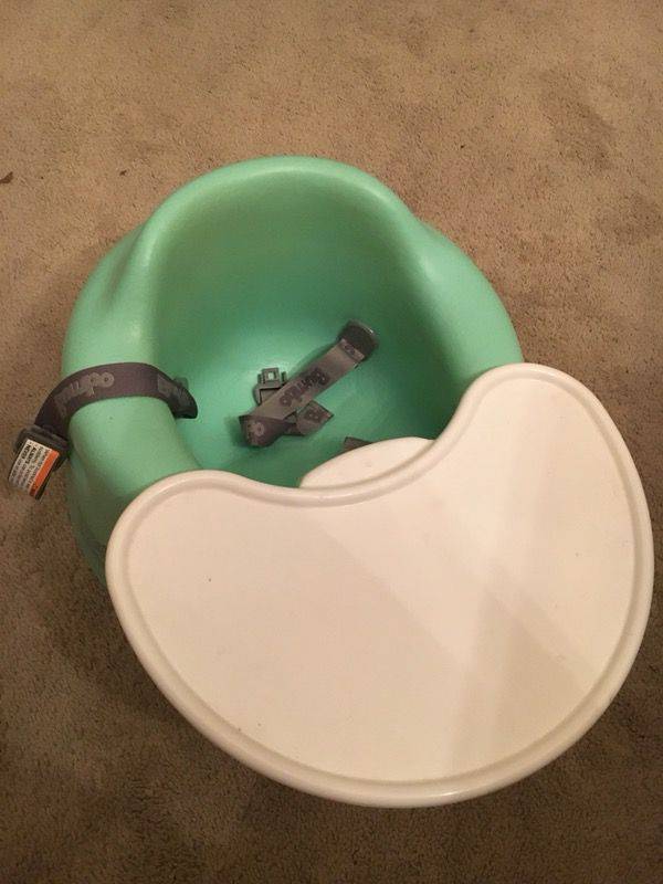 Green Bumbo seat with play tray