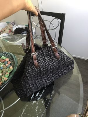 Very beautiful woven leather bag with skin straps