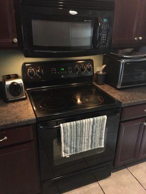 Kitchen set whirlpool Fridge.,dishwasher,microwave and stove.