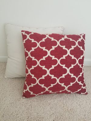 4 pillows. 2 solid light color an 2 red and off white. Lightly used. 18x18