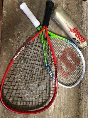 Tennis or hand ball pair of rockets.