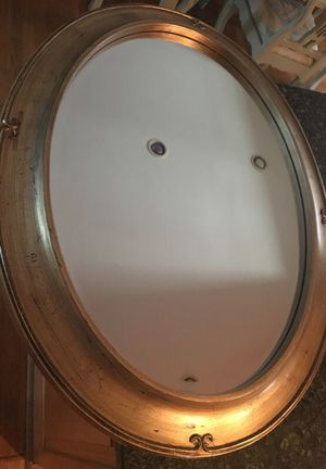 Oval distressed mirror