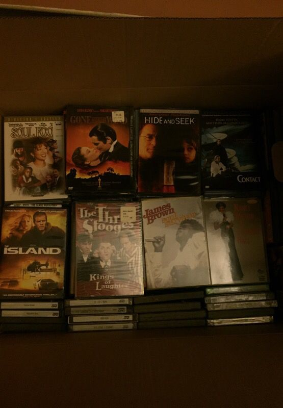 Three full boxes of DVDs.