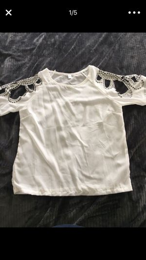 Brand new tops/4 tops one price/new some with tags and some without tags never worn. Size Large and X L. Tops run small Selling all for one group pri