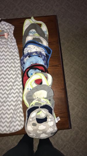 Swaddle sacks and bibs