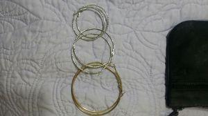 Bracelets and 3 pairs of hoop earings with black baggie