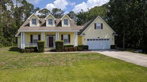Custom home on 1.55 acre lakefront lot