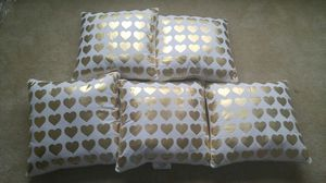 5 gold heart pillows with gold trim
