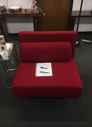 Red fabric chair bed