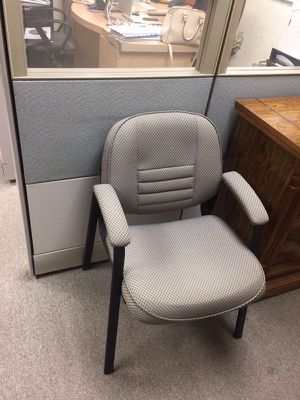 Two identical waiting room chairs