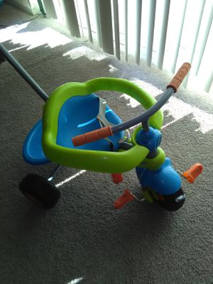 Kids tricycle with push handle ( excellent condition )