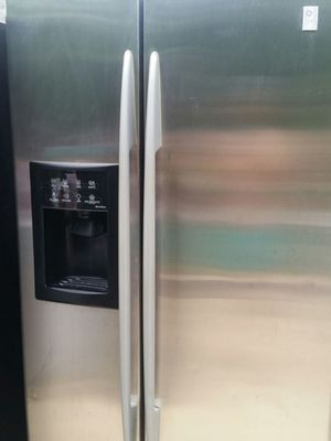 Stainless refrigerator side x side