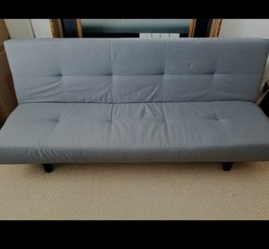 Futon for sale. Less than a year old. Barely used. $49