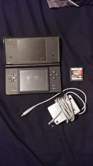 Nintendo DSi with charger and game
