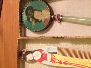 Antique chinese handheld mirror with wooden comb
