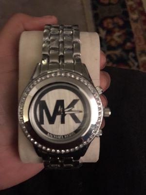 Vendo este lindo reloj MK