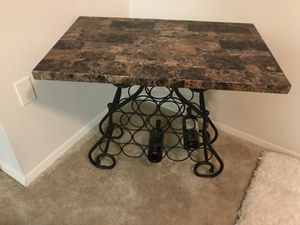 Rectangular marble top table with black steel base
