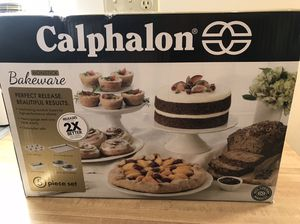 "calphalon 5 piece bakeware set 6 cup muffin pan 12"" x 17"" baking sheet Medium loaf pan Two round 9"" cake pans"