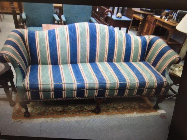 Camel back sofa, mahogany sturdy frame