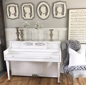White piano and bench