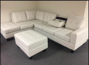 Brand new white leather sectional with ottoman (no sale tax)