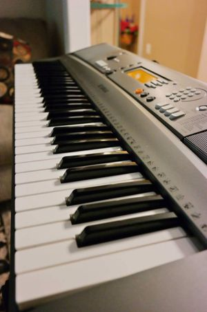 Excellent Yamaha Electronic Keyboard with stand.