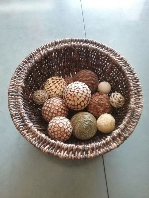 Large brown wicker basket with unique collection of