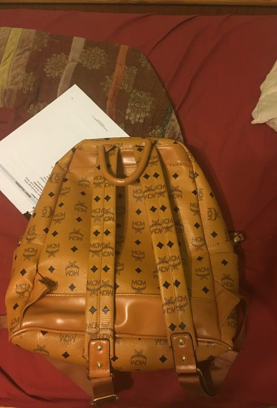 Real studded mcm medium backpack selling for the low